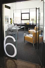 Executive offices are spacious and feature custom- made desks and ...
