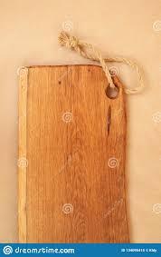 Closeup Of Oak Chopping Board On Craft Paper Restaurant