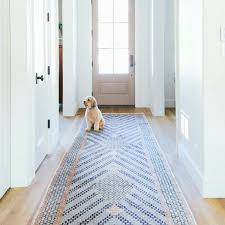 best hallway runner blue mosaic pattern rug in a white hallway with a dog sitting on