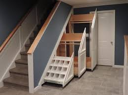 Interior Gorgeous Under Stair Storage For Coats White Pull Out Coak Hanger  Gray Stone Tiled Floor