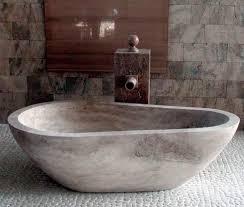 freestanding stone bathtub. freestanding bathtub / oval stone - piedra pavo e