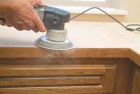 When preparing countertops for laminate, sand everything flat and smooth  including seams and the self