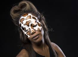 a beautiful is made up with giraffe texture using makeup art