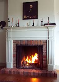 red brick fireplace design with brass fire pit cover