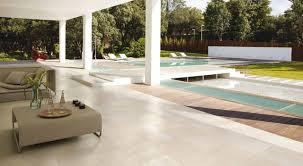 Modern indoor outdoor patio pool area with porcelain floors Modern