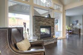 double sided fireplace indoor outdoor double sided fire place with window above