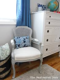 it kind of reminds me of a restoration hardware chair it is a great neutral piece and a little pillow can always be added for some patter and color