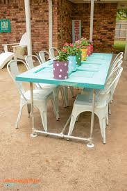 old door patio table make a fun table with plumbing conduit and an old door