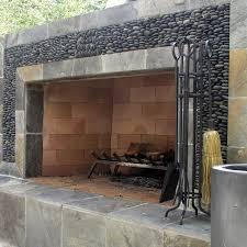river rock and slate outdoor fireplace surround studio h landscape architecture via atticmag