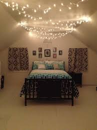 Fairy Lights On Ceiling Of Bedroom For