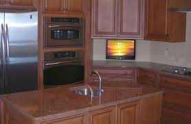 custom cabinets tv. Perfect Cabinets Small TV Drops Down From Kitchen Cabinet With Custom Cabinets Tv V