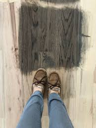 changing the color of the wood flooring can dramatically change the vibe and look of our house and literally i could not be more excited