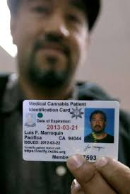 luis marroquin holds up his renewed cal cans patient identification card at the patient id center