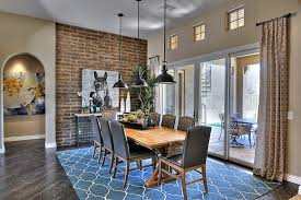 los angeles indoor brick wall with brown mirrors dining room traditional and beige blue rug