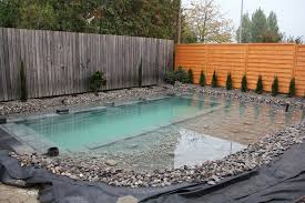 diy natural swimming pond filling it up with water
