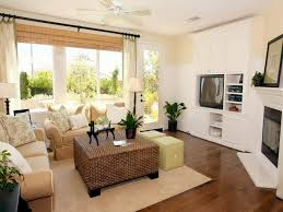 cute apartment decorating ideas. Interior. White Wooden Tv Cabinet And Rectangle Brown Rattan Ottoman On  Beige Rug Connected By Cute Apartment Decorating Ideas