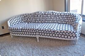 reupholster that old sofa brooke from brooklyn berry designs reupholstered this entire tufted sofa with a fun polka dot print with her sister in aw