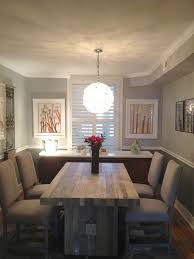 contemporary dining room with pendant light hardwood
