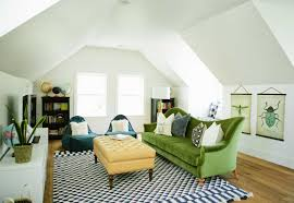 Cozy Attic Living Room Design With Warm Royal Sofa In Green Color And Black  White Carpet