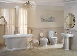 bathroom ideas mini crystal chandelier over white oval soaking bathtub and rounded mirror over