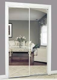 image mirrored closet. i like the wall color and white trim around mirrored closet doors image