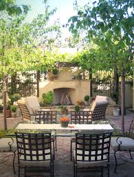 garden furniture patio uamp: this outdoor space by molly wood garden design includes a rustic theme fireplace and lounge area