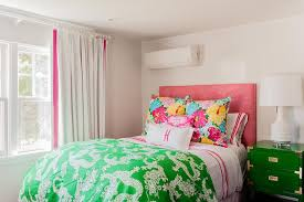 pink and green teen girl bedroom with green campaign nightstand