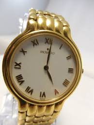 mens gold plated movado museum dress watch 87 a2 870 movado gold plate stainless steel r numeral watch 87 a2 870 swiss quartz