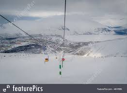 ski resort cableway with wooden chairs hibiny russia