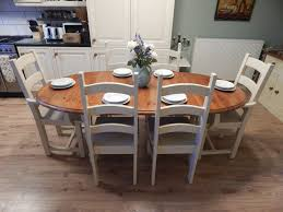 here is a gorgeous professionally upcycled solid pine extending farmhouse dining table and 6 ladderback