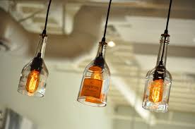 fascinating 3 clear glass bottle pendant lamp feature black lamp holder and also black cable