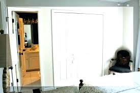 these tinted sliding glass doors define the bedroom area and allow french sliding glass doors french
