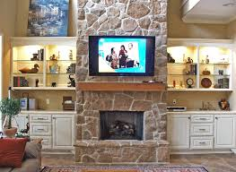 built in s at stone fireplace