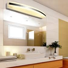over vanity lighting. bathroom cabinetscrystal wall lighting with frosted glass diffuser over a mirror vanity