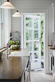 A single french door perfect from kitchen to deck Cute little