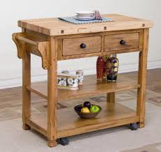 small maple wooden butcher block kitchen work table set on wheels with storage and drawer plus towel hanger for small kitchen spaces ideas