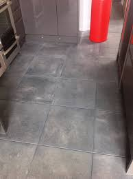 textured porcelain tile with charcoal grey grout in kendal