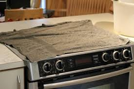 cover stovetop with towel