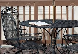 deck wrought iron table. A Pair Of Reading Glasses Rests On Top An Open Bible Wrought- Deck Wrought Iron Table