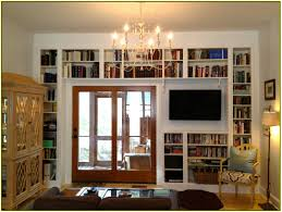 cool ikea wall wall shelves white wall with books door and chandeliers and tv amazing