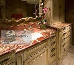 red marble countertop in bathroom stock photo