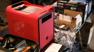 Yeah, I know, it looks like the bastard child of a Shuttle cube PC and an  Apple Mac Pro chassis. But it's red, capacious, and I like it. And building  in it ...
