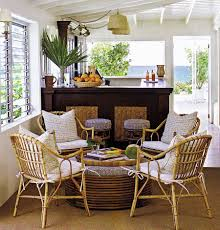 cal sunroom design with unique rattan seating with white bolster and round rattan coffee table with