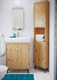 bathroom toilet and sink cabinets. a small bathroom with wash-basin cabinet and corner in light brown toilet sink cabinets