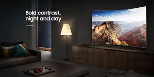 QLED TV is in a living room and via a slide interaction, the image on