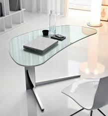 transpa glass bottle and laptop over unique traspa glass table with single leg and white