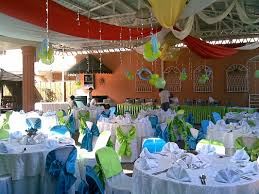 backyard party decorations combined with white tent and colorful top clothes also round tables in white table clothes plus white upholatered chairs