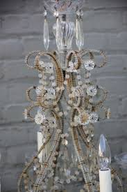 romantic six light italian macaroni beaded chandelier with crystal bobeches for