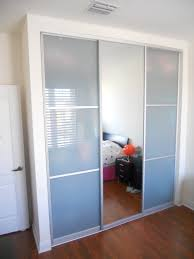 furniture large frosted glass sliding closet door with alumunium frames connected by dark brown wooden