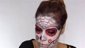 flower details on the cheeks easy day of the dead makeup tutorial perfect for